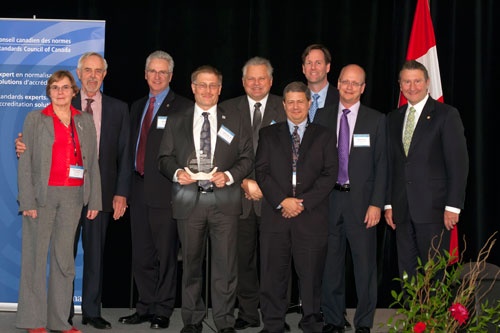Members of CSC/IEC/TC111 receive the Special Achievement award, accompanied by John Walter and Sam Shaw.