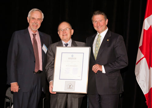 St. John Blakely receives the Roy. A. Phillips award, accompanied by John Walter and Sam Shaw.