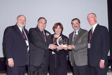 Peter Clark and Hugh Krentz present the Corporate Commitment award to Gilles Béland, Jocelyne Fortin and Jacques Régis