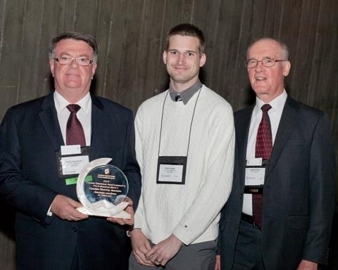 Photo of Pierre Guimond and Keith Jansa, representing the CEA, are the 2010 recipients of the Corporate Commitment Award, accompanied by SCC Chairman, Hugh Krentz.