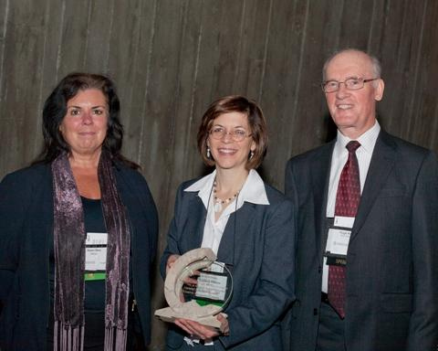Photo of Karen Pero and Christiane Villemure, representing NRCan, are the 2010 recipients of the Corporate Commitment Award, accompanied by SCC Chairman, Hugh Krentz.