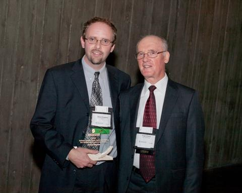 Photo of Mr. Darryl Kingston, the 2010 recipient of the McMahon Dedicated Service Award, accompanied by SCC Chairman, Hugh Krentz.
