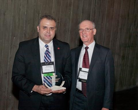 Photo of Dr. Wael Badawy, the 2010 recipient of the SCC Award of Excellence, accompanied by SCC Chairman, Hugh Krentz.