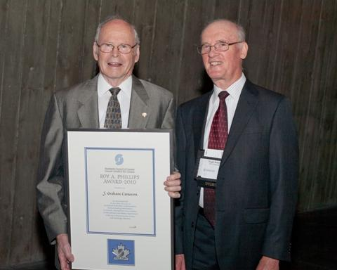 Photo of Mr. Graham J. Cameron, the 2010 recipient of the Roy A. Phillips Award, accompanied by SCC Chairman, Hugh Krentz.