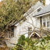 Tree falling on house