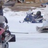 Snowmobile and sled